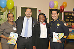 HISD Board of Education member Rhonda Skillern-Jones (far left) and Harris County Sheriff Adrian Garcia (far right) were among the guest readers at Cook Elementary School's Read Across America celebration.