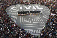 People who participate form a heart around the sign Civil during a demonstration to support civil society in Budapest, Hungary on April 12, 2017. ATTILA VOLGYI