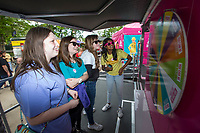 NWA Democrat-Gazette/BEN GOFF @NWABENGOFF<br /> Kaylea Greenfield (from left), 13, of Bentonville, Emalee Hale, 14, of Pea Ridge, Ava Bennett, 13, of Bentonville and Ria Raam, 13, of Bentonville, play a game at the Barbie trailer Friday, May 10, 2019, at the Inclusion Town area at Compton Gardens during the Bentonville Film Festival.