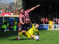 Lincoln City's Michael Bostwick vies for possession with Cheltenham Town's Billy Waters<br /> <br /> Photographer Chris Vaughan/CameraSport<br /> <br /> The EFL Sky Bet League Two - Lincoln City v Cheltenham Town - Saturday 13th April 2019 - Sincil Bank - Lincoln<br /> <br /> World Copyright &copy; 2019 CameraSport. All rights reserved. 43 Linden Ave. Countesthorpe. Leicester. England. LE8 5PG - Tel: +44 (0) 116 277 4147 - admin@camerasport.com - www.camerasport.com