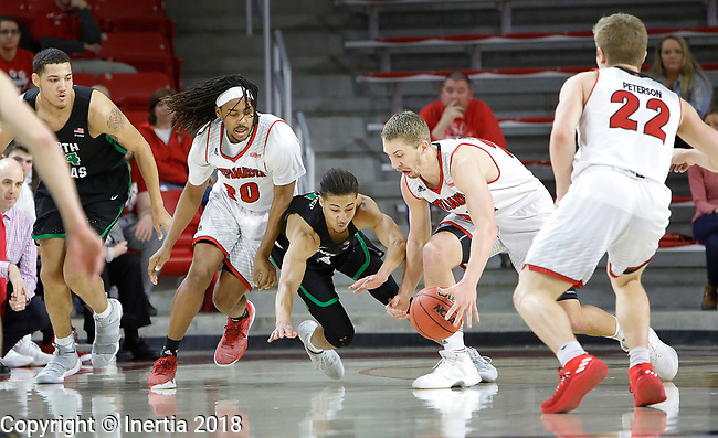 VERMILLION, SD: MARCH 14:  Tyler Hagedorn #25 of South Dakota tries to get a handle on a loose ball as teammate Brandon Armstrong #20 and Ryan @oolridge #0 of North Texas give chase during the 2018 CBI Basketball Tournament at the Sanford Coyote Sports Center in Vermillion, S.D.  (Photo by DIck Carlson/Inertia)