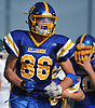 Daniel Wilson #88 of Kellenberg reacts after a stop on fourth down gave the ball back to the Firebirds in the second quarter of a CHSAA varsity football game against Holy Trinity at Mitchel Athletic Complex in Uniondale on Sunday, Sept. 17, 2017. Kellenberg won by a score of 45-0.