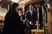 United States President Barack Obama lights candles as he tours the crypt containing the birthplace of Jesus during his visit to the Church of the Nativity in Bethlehem, the West Bank, March 22, 2013. .Mandatory Credit: Pete Souza - White House via CNP