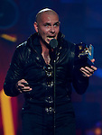 MIAMI, FL - JULY 17: Pitbull onstage during the Premios Juventud 2014 Awards at BankUnited Center on July 17, 2014 in Miami, Florida. (Photo by Johnny Louis/jlnphotography.com)