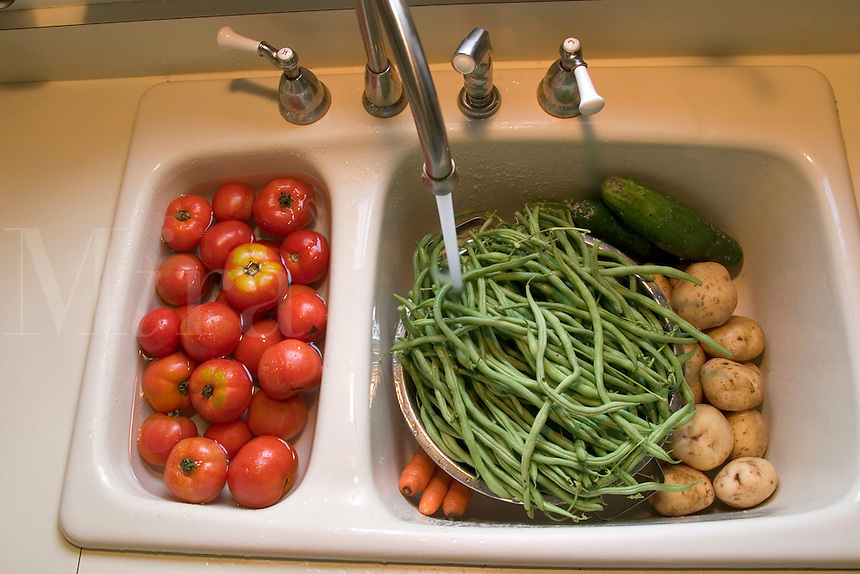 Washing vegetables.