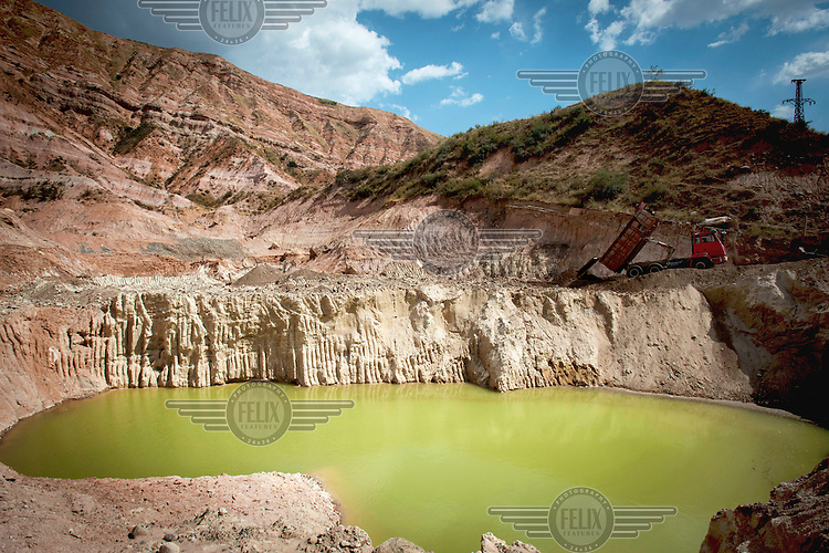 Highly radioactive water at Tailing Dump No.3 where underground water has mixed with a huge amount of radioactive waste and radionuclides, such as uranium, strontium and cesium. During the past 2 years, 60 workers from all over Kyrgyzstan have been working on a project for the relocation of Tailing Dump No.3 to Dump No.6 (3km away).
