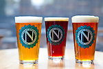 Tap beers from left to right: The Eugene Collaboration 2011, Believer Double Red, and the Total Domination IPA.  Ninkasi is a regional craft brewery making beers in the Northwest style. Their location in Eugene, Oregon affords regional access for their primary ingredients, which include: Water, Malt, Hops and Yeast. With the strong regional hop industry, and access to the McKenzie River, source of some of the cleanest water in the world, Ninkasi is well positioned for their goal of brewing high quality craft beers. The beer's namesake, Ninkasi, was the Sumerian goddess of fermentation.