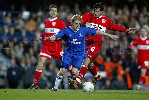 9 March 2004: Chelsea winger DAMIEN DUFF is tripped by Fernando Meira for the ball during the UEFA Champions League match between Chelsea and VfB Stuttgart at Stamford Bridge. The game finished goalless with Chelsea qualifying for the next round Photo: Glyn Kirk/Action Plus...soccer football 040309 player foul fouls fouled