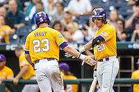LSU Tigers third baseman Conner Hale (20) greets teammate Jake Fraley (23) after he scored against the TCU Horned Frogs in Game 10 of the NCAA College World Series on June 18, 2015 at TD Ameritrade Park in Omaha, Nebraska. TCU defeated the Tigers 8-4, eliminating LSU from the tournament. (Andrew Woolley/Four Seam Images)