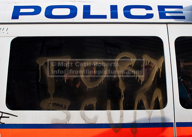 Anti government graffiti sprayed on the side of a police van at the second set of student protests in central London. The police van, left on Whitehall amidst the kettled marchers, became the focus for media and demonstrators alike. 24/11/10