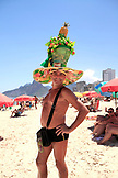 BRAZIL, Rio de Janiero, a man sporting a festive hat on Ipanema Beach, which is located bewteen Leblon and Arpoador