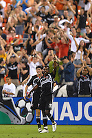 DC United forward Luciano Emilio (11) celebrates his 87th minute goal with teammate Joshua Gros (17). DC United defeated Colorado Rapids 4-1, at RFK Stadium in Washington DC, Thursday, June 28, 2007.