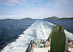 Ship's wake in sea of Caledonian MacBrayne ferry ship leaving Barra, Outer Hebrides, Scotland, UK
