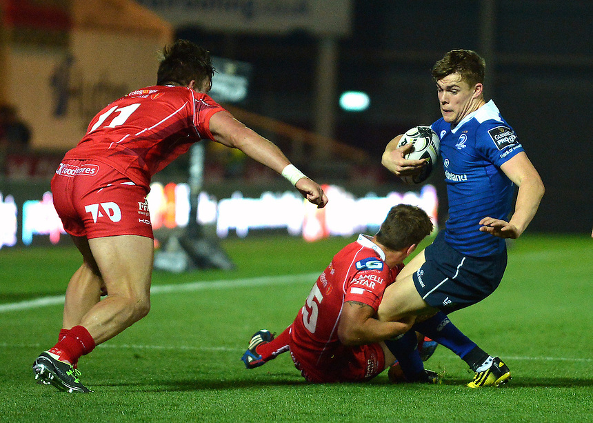Leinster's Gary Ringrose is tackled by Scarlets' Aled Thomas<br /> <br /> Photographer Ian Cook/CameraSport<br /> <br /> Rugby Union - Guinness PRO12 - Scarlets v Leinster - Friday 16th October 2015 - Parc y Scarlets - Llanelli<br /> <br /> &copy; CameraSport - 43 Linden Ave. Countesthorpe. Leicester. England. LE8 5PG - Tel: +44 (0) 116 277 4147 - admin@camerasport.com - www.camerasport.com