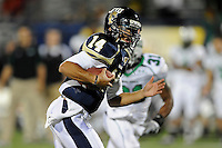 14 November 2009:  FIU quarterback Wayne Younger (14) scrambles for a touchdown in the second half as the FIU Golden Panthers defeated the North Texas Mean Green, 35-28, at FIU Stadium in Miami, Florida.