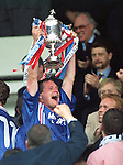 Paul Gascoigne salutes the Rangers fans as he holds the Scottish Cup aloft in 1996