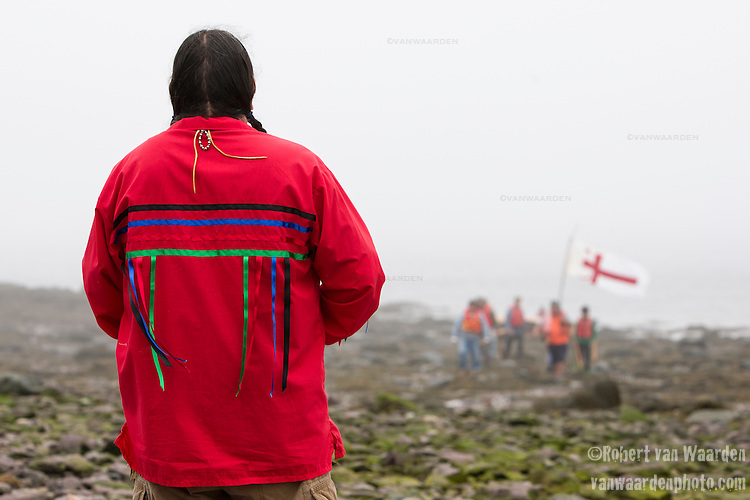 Ron Tremblay from the Wolastoq Grand Council welcomes the paddlers from the Mi'kmaq Nation on the beach at Red Head. On May 30, 2015, over 500 Canadian citizens and First Nations marched in Red Head, Saint John, at the End of the Line for the proposed Energy East pipeline. The people were protesting the proposed mega pipeline and the tank terminal that would destroy and the Red Head community and endanger the Bay of Fundy. If approved, TransCanada's Energy East pipeline would travel 4600km from Alberta to Saint John, New Brunswick, shipping 1.1 million barrels of crude oil and bitumen for export through the Bay of Fundy, a critical habit for Right whales and home to thousands of jobs in Tourism and Fishing.