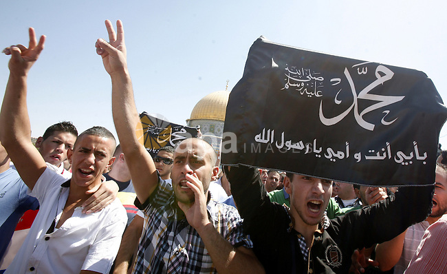 Palestinians shout slogans during a demonstration against the controversial film 'Innocence of Muslims' in front of al-Aqsa Mosqe in Jerusalem, on September 14, 2012. The controversial low budget film reportedly made by an Israeli-American which portrays Muslims as immoral and gratuitous, sparked fury in Libya, where four Americans including the ambassador were killed on Tuesday when a mob attacked the US consulate in Benghazi, and has led to protests outside US missions in Morocco, Sudan, Egypt, Tunisia and Yemen. Photo by Mahfouz Abu Turk