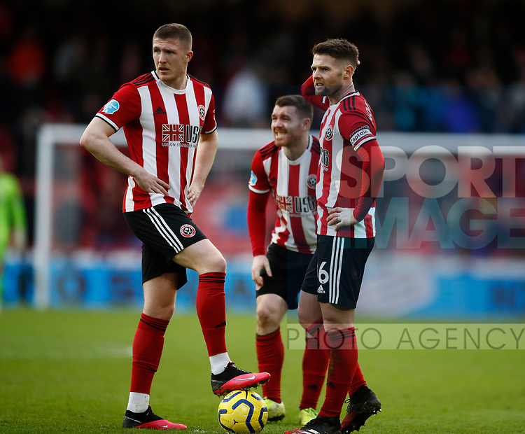 John Lundstram of Sheffield Utd and Oliver Norwood of Sheffield Utd during the Premier League match at Bramall Lane, Sheffield. Picture date: 9th February 2020. Picture credit should read: Simon Bellis/Sportimage