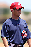 GCL Nationals Bobby Williams #9 talking with the umpires before a game against the GCL Mets at the Washington Nationals Minor League Complex on June 20, 2011 in Melbourne, Florida.  The Nationals defeated the Mets 5-3.  (Mike Janes/Four Seam Images)