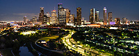 Houston Skyline After Dark Pano - Houston Skyline after dark with the cityscape of the high rise buildings in downtown in a pano. The Allen Parkway is well lit as the cars flow in and out of the city. From this view you can see many well know skyscrapers like the Chevron buildings also know as Smith Street, the Chase Tower, Well fargo and Heritage Plaza to name just a few.