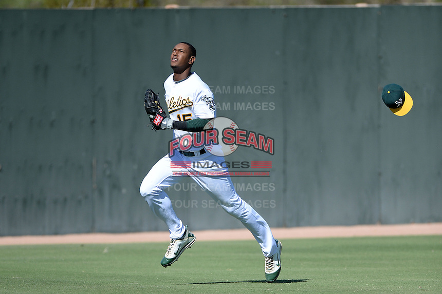 Oakland Athletics outfielder Shawn Duinkerk (15) loses his hat chasing down a foul ball during an instructional league game against the San Francisco Giants on September 27, 2013 at Papago Park Baseball Complex in Phoenix, Arizona.  (Mike Janes/Four Seam Images)