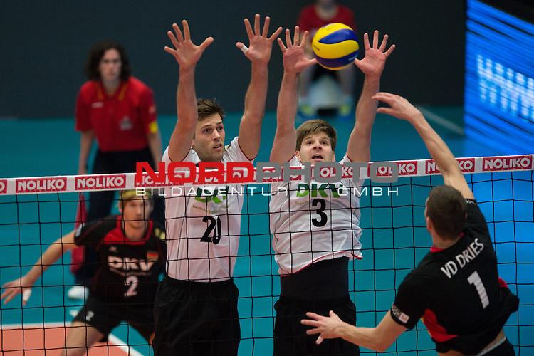 29.12.2013, Lotto Dome, Maaseik<br /> Volleyball, Belgien vs. Deutschland<br /> <br /> Block / Doppelblock Philipp Collin (#20 GER), Sebastian Schwarz (#3 GER) - Angriff Bram van den Dries (#1 BEL)<br /> <br />   Foto &copy; nordphoto / Kurth