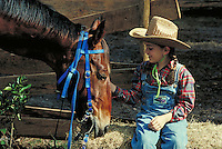 Equestrian 4 Young girl petting her horse. Little girl. Douglaston NY.