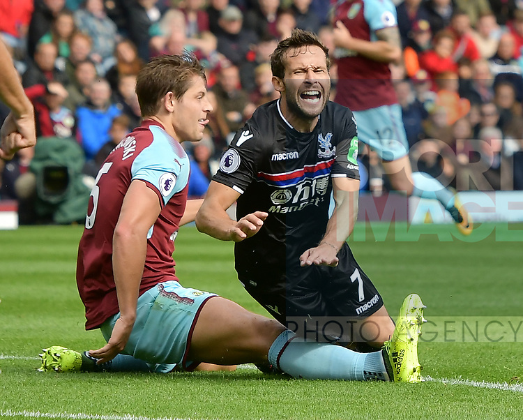 Burnley's James Tarkowski and Crystal Palace's Yohan Cabaye clash during the premier league match at the Turf Moor Stadium, Burnley. Picture date 10th September 2017. Picture credit should read: Paul Burrows/Sportimage
