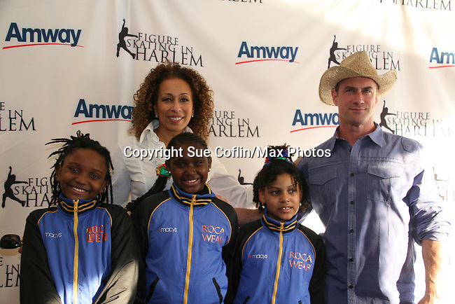 Law & Order SVU's Tamara Tunie (As The World Turns) & Christopher Meloni & skaters at Skating with the Stars (celebrities & Olympic skaters), a benefit gala for Figure Skating in Harlem on April 6, 2010 at Wollman Rink, Central Park, New York City, New York. (Photo by Sue Coflin/Max Photos)