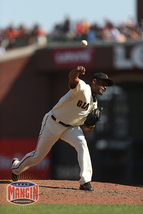 SAN FRANCISCO - SEPTEMBER 27:  Santiago Casilla of the San Francisco Giants pitches during the game against the Arizona Diamondbacks at AT&T Park on September 27, 2012 in San Francisco, California. (Photo by Brad Mangin)