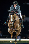 Kevin Staut of France rides Estoy Aqui de Muze HDC in action at the Longines Grand Prix during the Longines Hong Kong Masters 2015 at the AsiaWorld Expo on 15 February 2015 in Hong Kong, China. Photo by Juan Flor / Power Sport Images