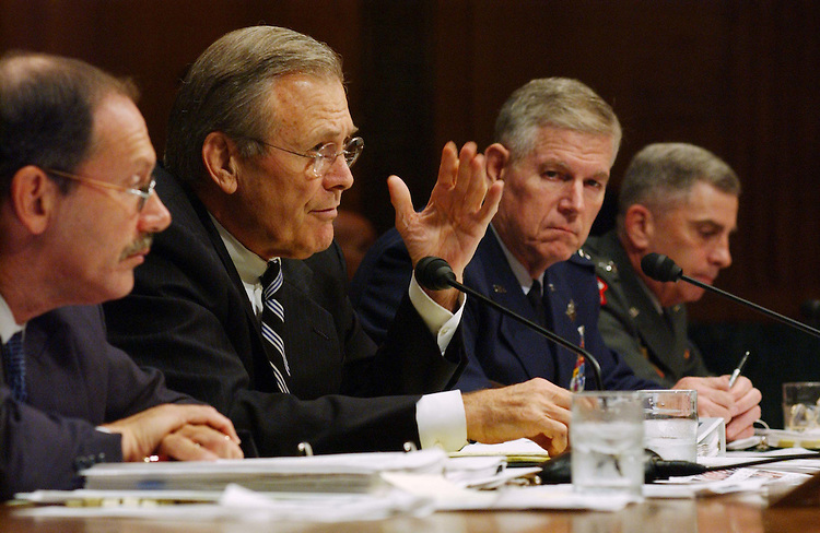 9/24/03.IRAQ SUPPLEMENTAL APPROPRIATIONS--Pentagon Comptroller Dov S. Zakheim, Defense Secretary Donald H. Rumsfeld, General Richard Myers, Chairman of the Joint Chiefs of Staff, and General John Abizaid, Commanding General United States Central Command, during the Senate Appropriations hearing on the President's fiscal year 2004 supplemental request for Iraq and Afghanistan. .CONGRESIONAL QUARTERLY PHOTO BY SCOTT J. FERRELL
