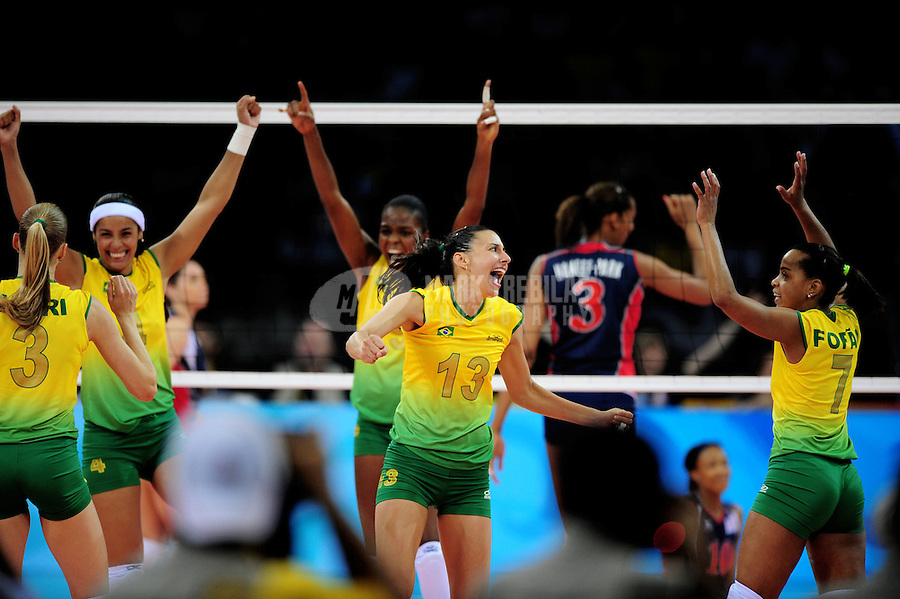 Aug. 23, 2008; Beijing, CHINA; Brazil players celebrate a point against USA in the womens volleyball gold medal game at the Capital Gymnasium during the 2008 Beijing Olympic Games. Brazil defeated USA 3 sets to 1 to win the gold medal.  Mandatory Credit: Mark J. Rebilas-