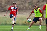 Getafe CF's  Alvaro Jimenez (l) and Emiliano Velazquez during training session. August 1,2017.(ALTERPHOTOS/Acero)