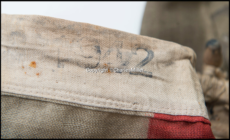 BNPS.co.uk (01202 558833)<br /> Pic: CharlesMiller/BNPS<br /> <br /> The flag was made in 1942.<br /> <br /> Remarkable survivor from the 'Longest Day'<br /> <br /> A smoke-stained and bullet-holed British flag that was the first raised on Sword Beach on D-Day has emerged for sale.<br /> <br /> Soldiers used the White Ensign to stake their claim on the Normandy beach during the historic invasion that changed the course of the Second World War.<br /> <br /> After it was hoisted, the 2.2ft by 4.4ft flag was clearly caught in the midst of battle as there are several bullet holes in it from where it had been shot by German fire.<br /> <br /> It is being sold for an estimated £3,000 at Charles Miller auctions of London.