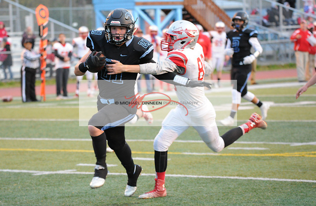 Derryk Snell breaks the tackle of Wasilla's Ethan Patnode at Chugiak High School Friday, Sept. 23, 2016.  Photo for the Star by Michael Dinneen