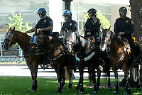24 Aug 08: A group of inter-agency police personnel and their horses are outfitted in riot gear prior to a planned march from the Colorado state capitol building to the Pepsi Center. On the day before the Democratic National Convention is scheduled to begin about 1,500 people participated in the ReCreate 68 rally, which included a march from the Colorado state capitol building to the Pepsi Center.