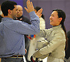 Elin Hu of Manhasset, right, gets congratulated by coach Mike Fabio after winning the Nassau County girls' fencing saber championship at Oyster Bay High School on Saturday, Jan. 30, 2016. Hu defeated Shannon Sarker of Great Neck North 15-12 to claim the county title.
