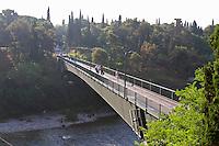 The viseci Cazela pedestrian bridge across the Moraca river. Podgorica capital. Montenegro, Balkan, Europe. Designed by Mladen Ulicevic.