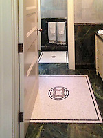Custom bath rug, a stone hand cut mosaic, shown in Nero Marquina, Chartreuse, Calacatta Tia, and Rosa Noriega.