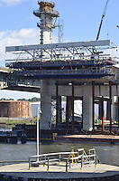 Pearl Harbor Memorial Bridge, New Haven Harbor Crossing Corridor, Interstate 95 in CT. Construction of Connecticut Department of Transportation Contract B as seen on September 9, 2011. New Northbound Span, Progress of the Replacement Bridge. When complete this will be the first Extradosed Bridge in the United States. This view includes Traveling Formwork, North Eastern Tower, river and Tomlinson Lift Bridge bumper pier.