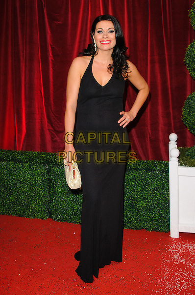 Alison King.British Soap Awards 2012, The London Television Centre, London, England..28th April 2012.full length dress white clutch bag black hand on hip.CAP/CJ.©Chris Joseph/Capital Pictures.