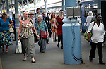 Crowd of passengers leaving their trains on the platform at Norwich railway station, Norfolk, England