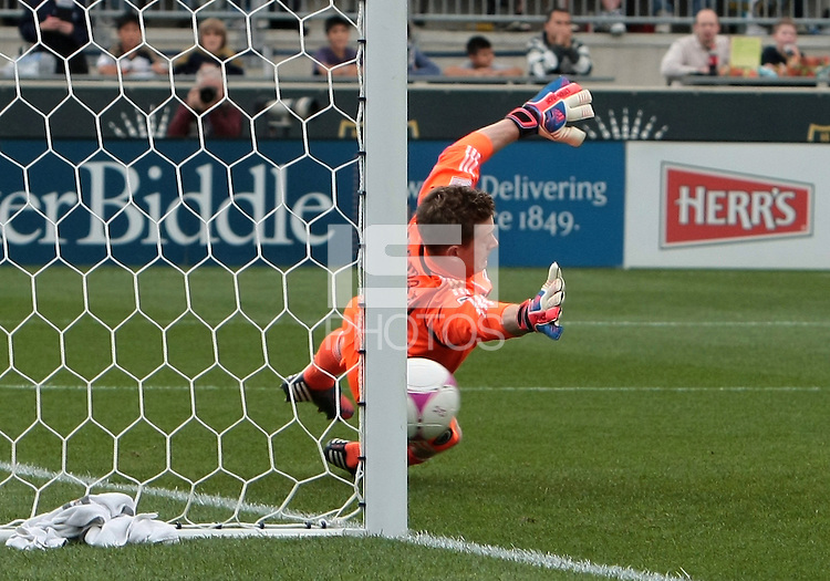 CHESTER, PA - OCTOBER 27, 2012:  Zac MacMath (18) of the Philadelphia Union can't stop a penalty kick by  Kenny Cooper (33) of the New York Red Bulls during an MLS match at PPL Park in Chester, PA. on October 27. Red Bulls won 3-0.
