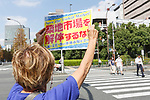 A woman against the closing of Tokyo's Tsukiji Wholesale Fish Market protests outside the fish market's main gate on October 10, 2018, Tokyo, Japan. Tokyo's iconic fish market closed its doors for the last time on October 6 for a move to a newly created facility, ''The Toyosu Fish Market,'' which will start operating on October 16. The wholesale fish market in Tsukiji first opened in the mid-1930s and was one of the Japanese capital's most popular destinations for international tourists. (Photo by Rodrigo Reyes Marin/AFLO)