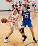WINSTED,  CT-021119JS18- Northwestern's Emma Propfe (13) has the ball knocked away by Housatonic's Christina Winburn (23) during their Berkshire League game Monday at Northwestern. <br /> Jim Shannon Republican American