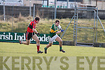 Kerry's James O'Donoghue and UCC's Eoin Hegarty.