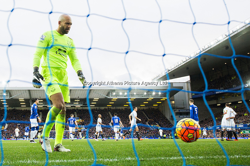 Tim Howard looks dejected as he picks the ball out of the net after Swansea City score the opening goal during the Barclays Premier League match between Everton and Swansea City played at Goodison Park, Liverpool