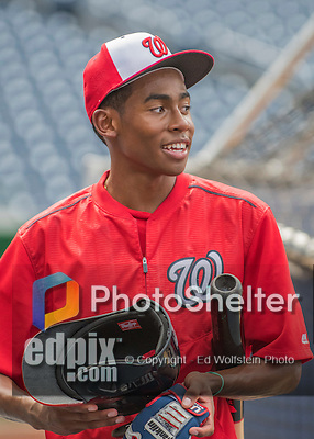 22 July 2016: Son of Washington Nationals Manager Dusty Baker, Darren Baker helps out with batting practice prior to a game against the San Diego Padres at Nationals Park in Washington, DC. The Padres defeated the Nationals 5-3 to take the first game of their 3-game, weekend series. Mandatory Credit: Ed Wolfstein Photo *** RAW (NEF) Image File Available ***
